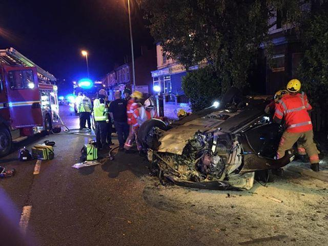 Fire crews at the scene after a car flipped onto its roof in a high speed police chase on Bury Old Road