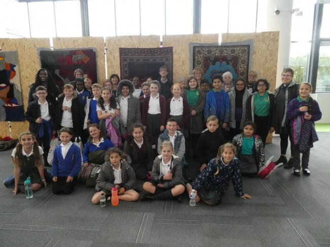 Pupils from All Saints CofE, St Luke's CofE and Bury and Whitefield Jewish primary schools on a school trip to the Holocaust Exhibition at the University of Huddersfield