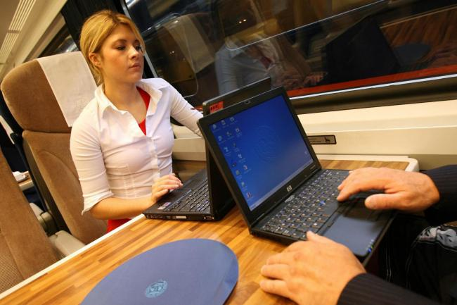 Train passengers using WiFi