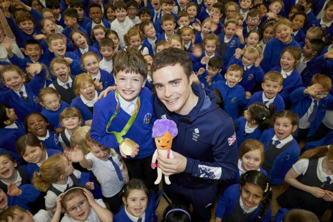 GOLD: Team GB cyclist Steven Burke at Higher Lane Primary School in Whitefield