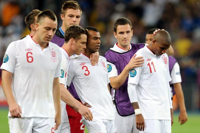 England's Ashley Cole and Ashley Young are consoled after missing in the shoot-out