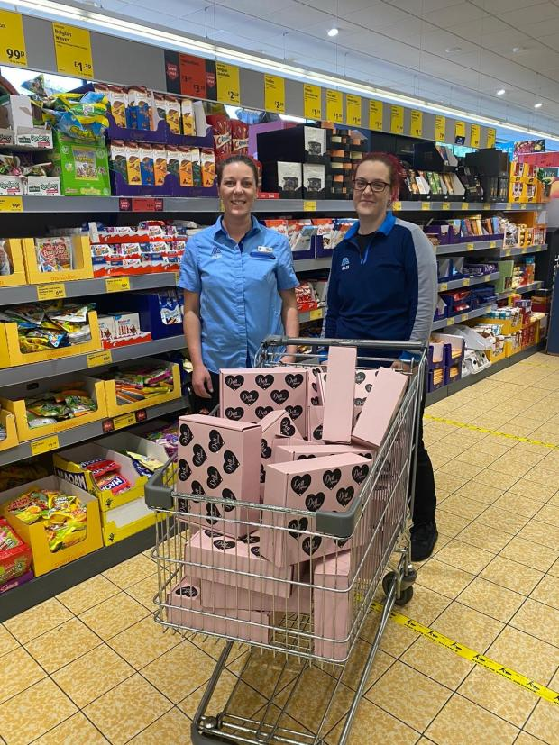 Prestwich and Whitefield Guide: Staff at Aldi in Prestwich with their Doll Beauty pamper packages