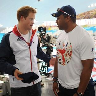 Prince Harry meets former soldier and Paralympic athlete Derek Derenalagi at a visit to the Aquatics Centre