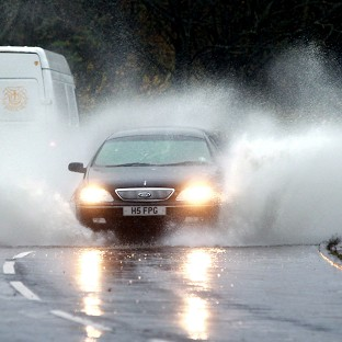 Traffic struggles through floodwater as more problems are expected