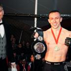 Prestwich and Whitefield Guide: Richard Buskin after winning the lightweight UFW champion belt