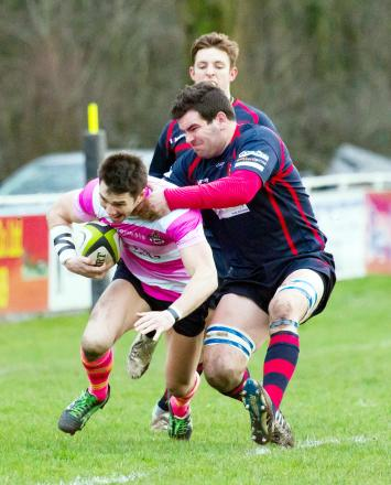 Sedgley Park's Richard Wainwright, left, in action against Chester