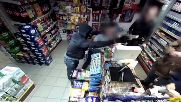 A robber with a gun threatens staff at Bargain Booze in Ramsbottom