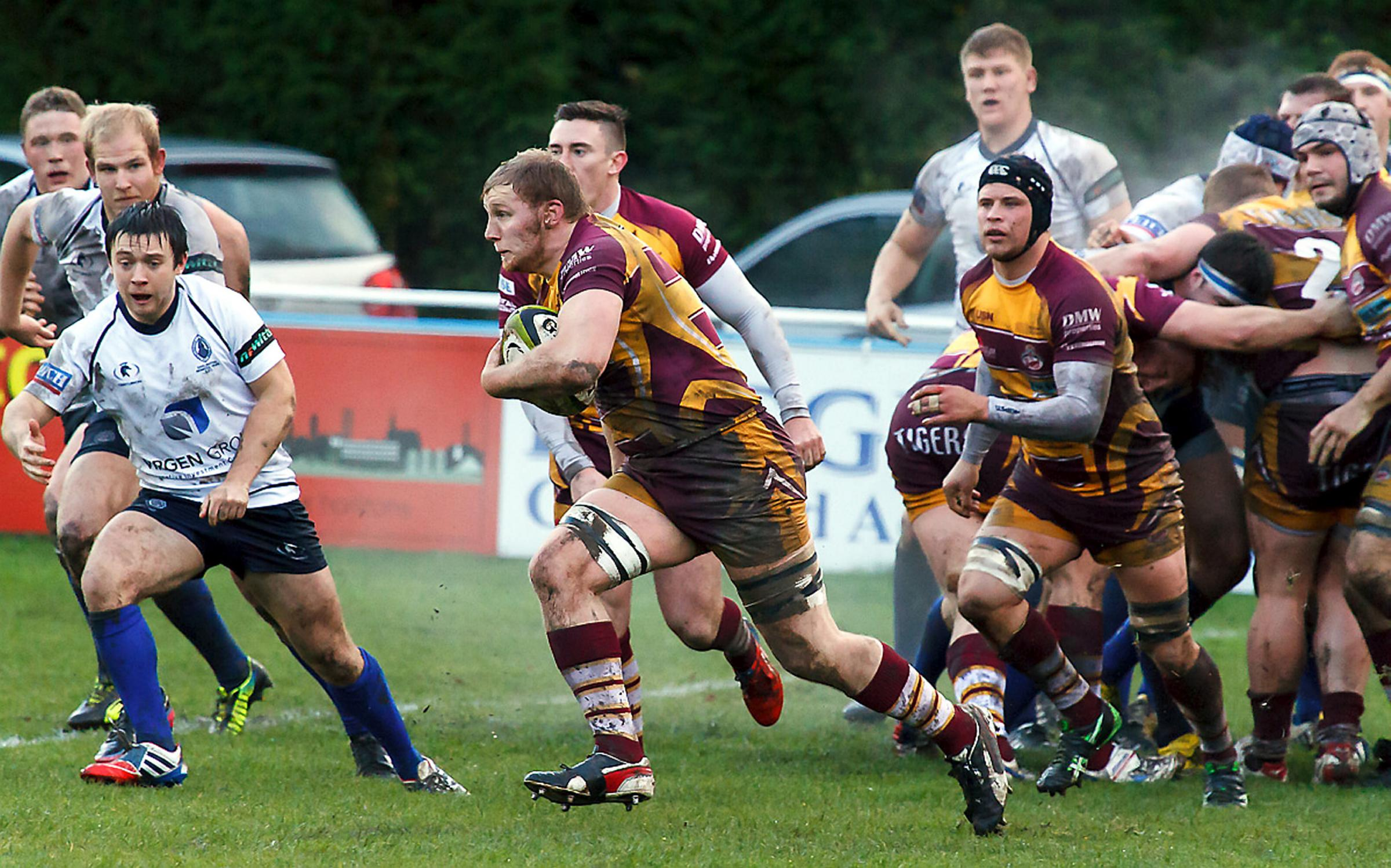 Sedgley's Matt Lamprey, centre with the ball, scored his team's sole try