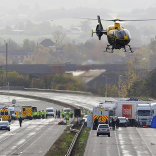 Emergency services work at the scene on the M5 motorway