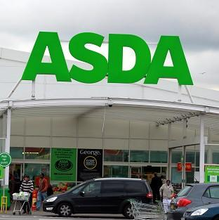 Asda has apologised after a customer was charged more than �50 for a cabbage at a store in the West Midlands