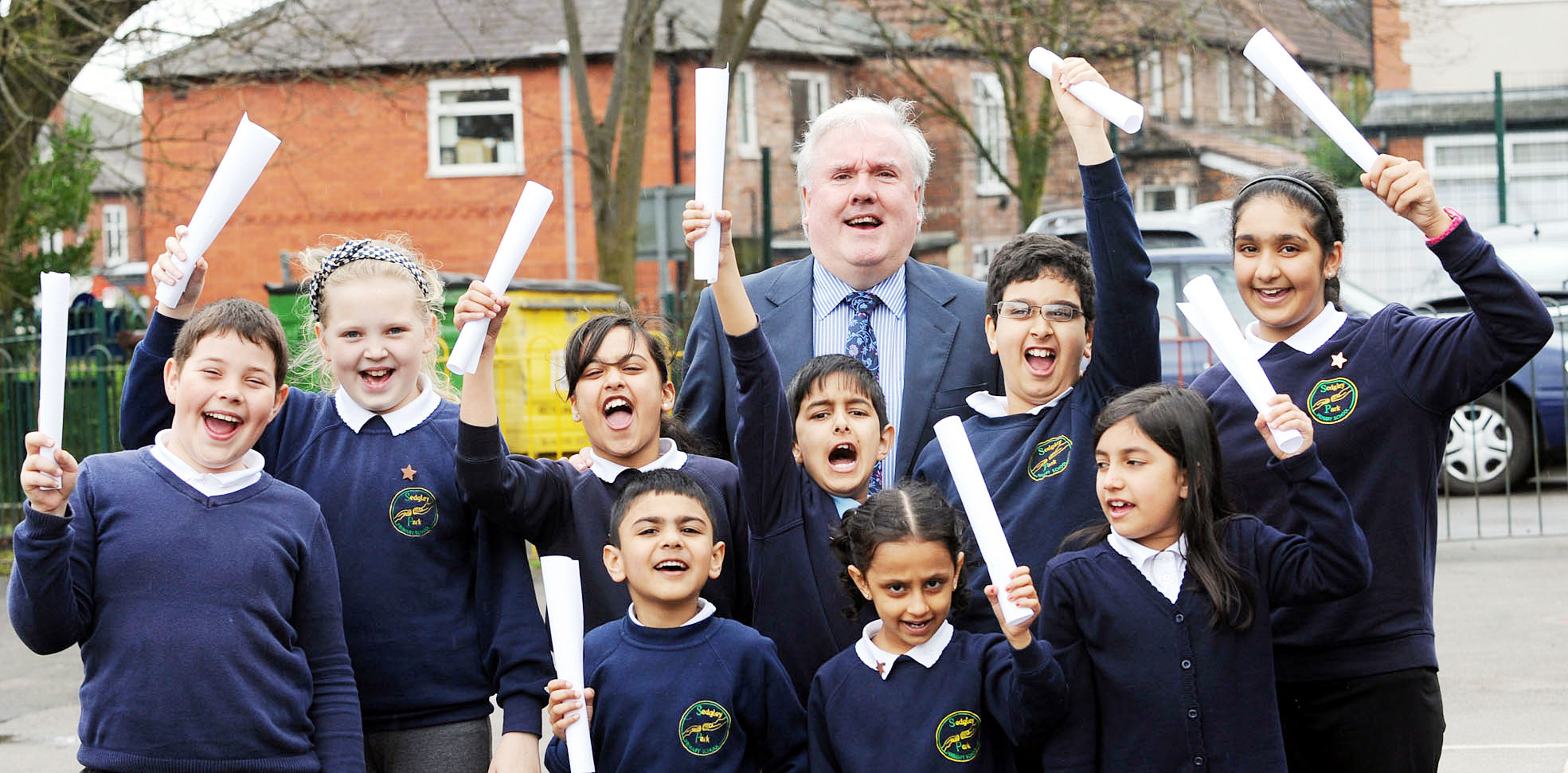 Headteacher Patrick Reid celebrates with Sedgley Park Primary pupils