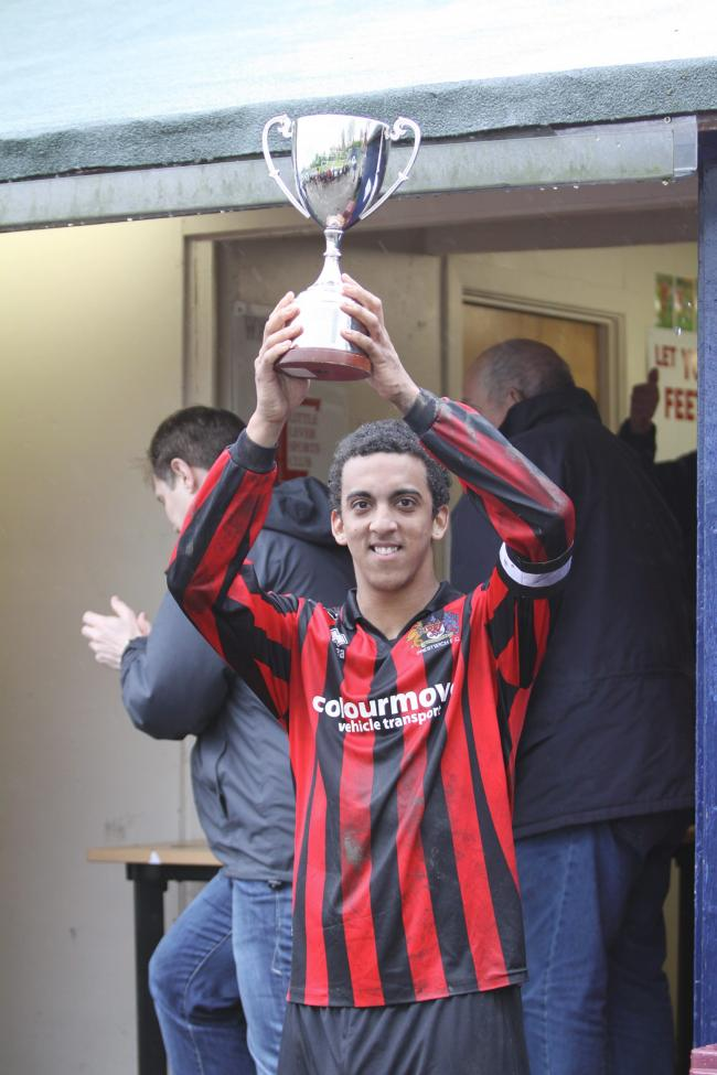 Prestwich captain Ashford Blake lifts the Lancashire Amateur League Cup