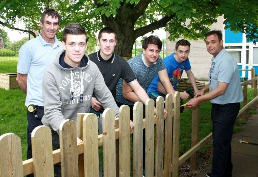 In the memorial garden are, from left, Michael Booth, a lecturer in carpentry and joinery at Bury College, students Andrew Duffy, Ryan Mullan, Aaron Heaton, Callum Stanley, and technician Chris H