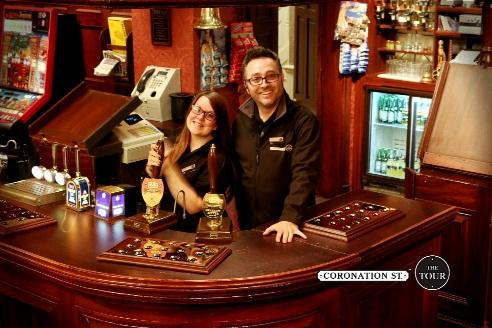 Paul Humphreys and Carla Wilson behind the bar at