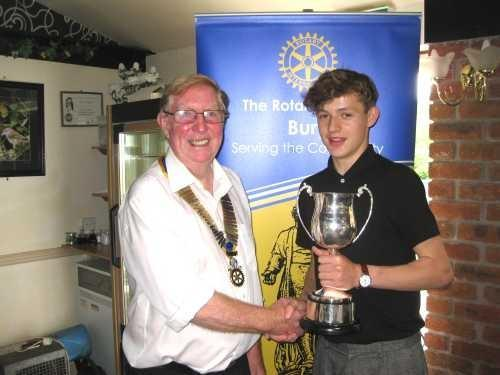 "Matthew Humphries, left, receives the Wilf Ainscow ""Ranger"" Trophy from David Norris, president of Bury Rotary Club"