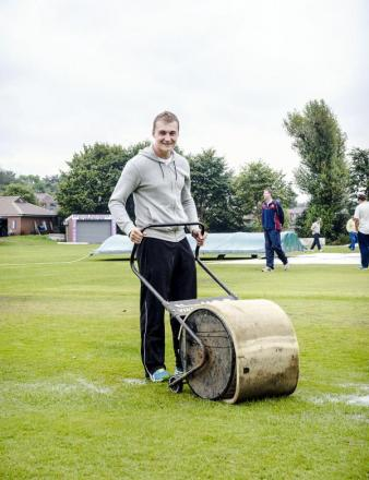 Sam Holden, pictured mopping up before last weekend's abandoned match against Stand, was back in the runs this week