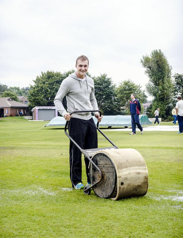 Sam Holden, pictured mopping up before last weekend's abandoned match against Stand, was back in th