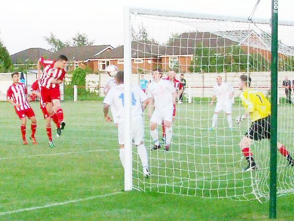 Mark Drew heads home against Hindsford