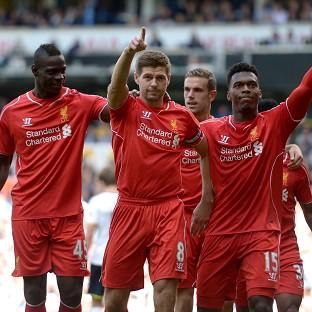 Steven Gerrard, centre, scored Liverpool's second goal in another big win over Tot