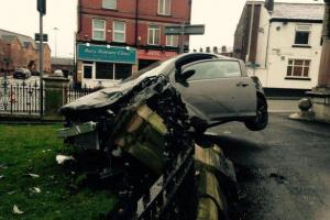 Car impaled on railings after driver loses control in early morning crash