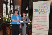 Event organiser Phyllis Lefevre presented a cheque for £565 to Grace's Place trustee Joan Grimshaw