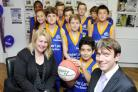 Higher Lane Primary School's basketball team Farrah Abbassy, and Teresa Bernardo, both aged 10, Bradley Hughes, Matthew Buck, Alex Lester, Daniel Galloway, Barbod Zerat, Sam Waddington, Charlie Hall and Jack Aankey, all aged 11, with Andrew Cardwell and L