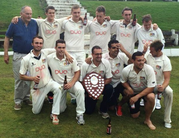 Prestwich players celebrate clinching the Lancashire County League title