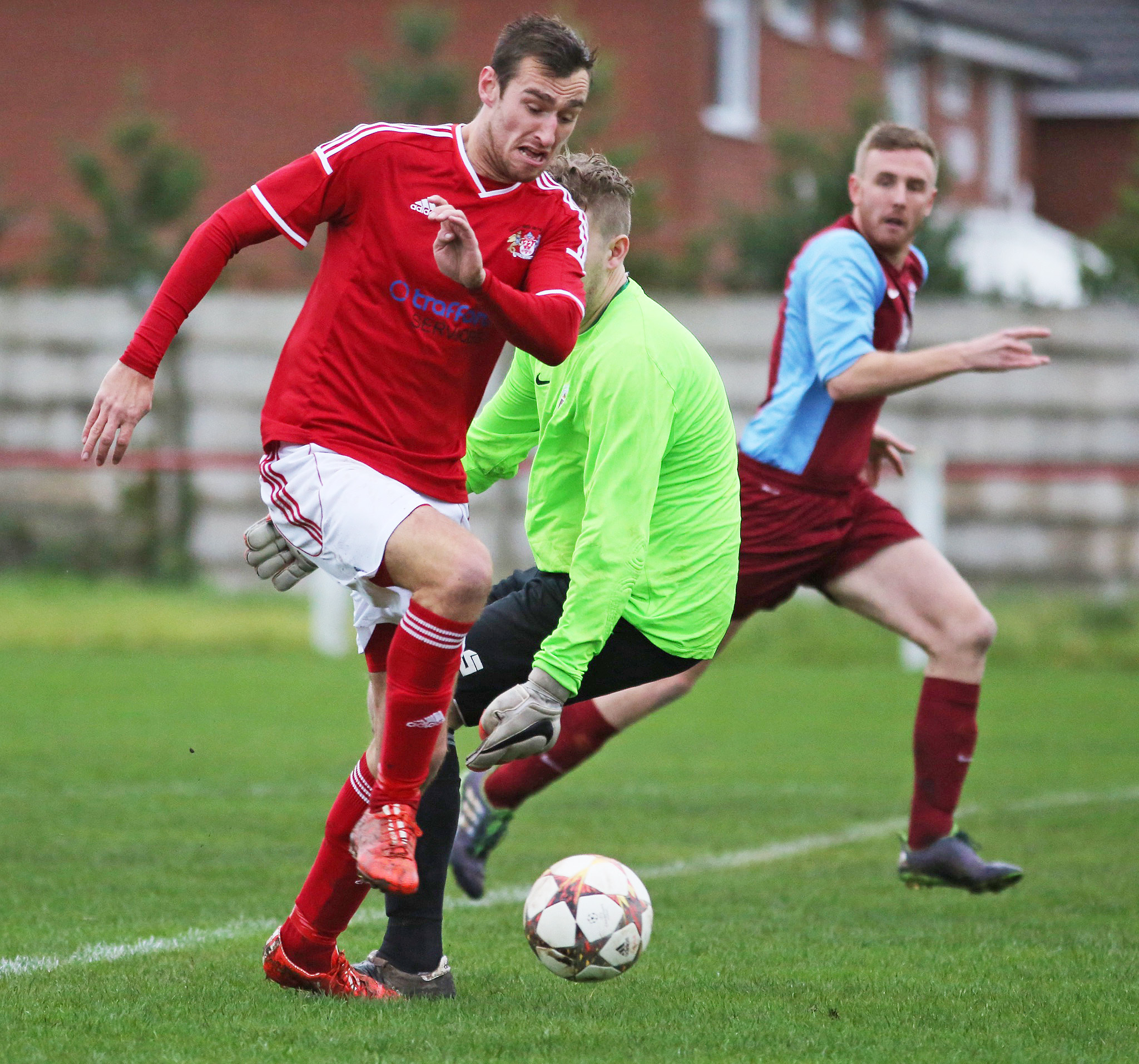 Jon Stephenson beats the keeper to slot home the second goal for Prestwich Heys