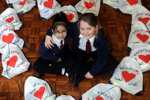 Class teacher Melissa Meek and pupils from Sedgley Park primary school with bags of toys collected for youngsters in Syria.