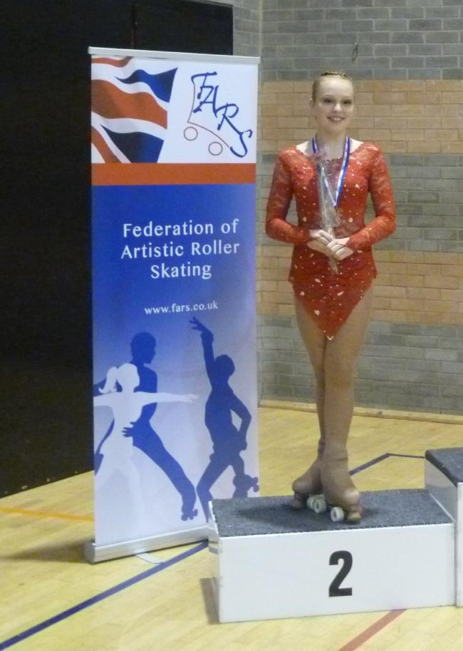 ON THE PODIUM: Whitefield skater Emma Thiele collects her silver medal at the British Free Championships