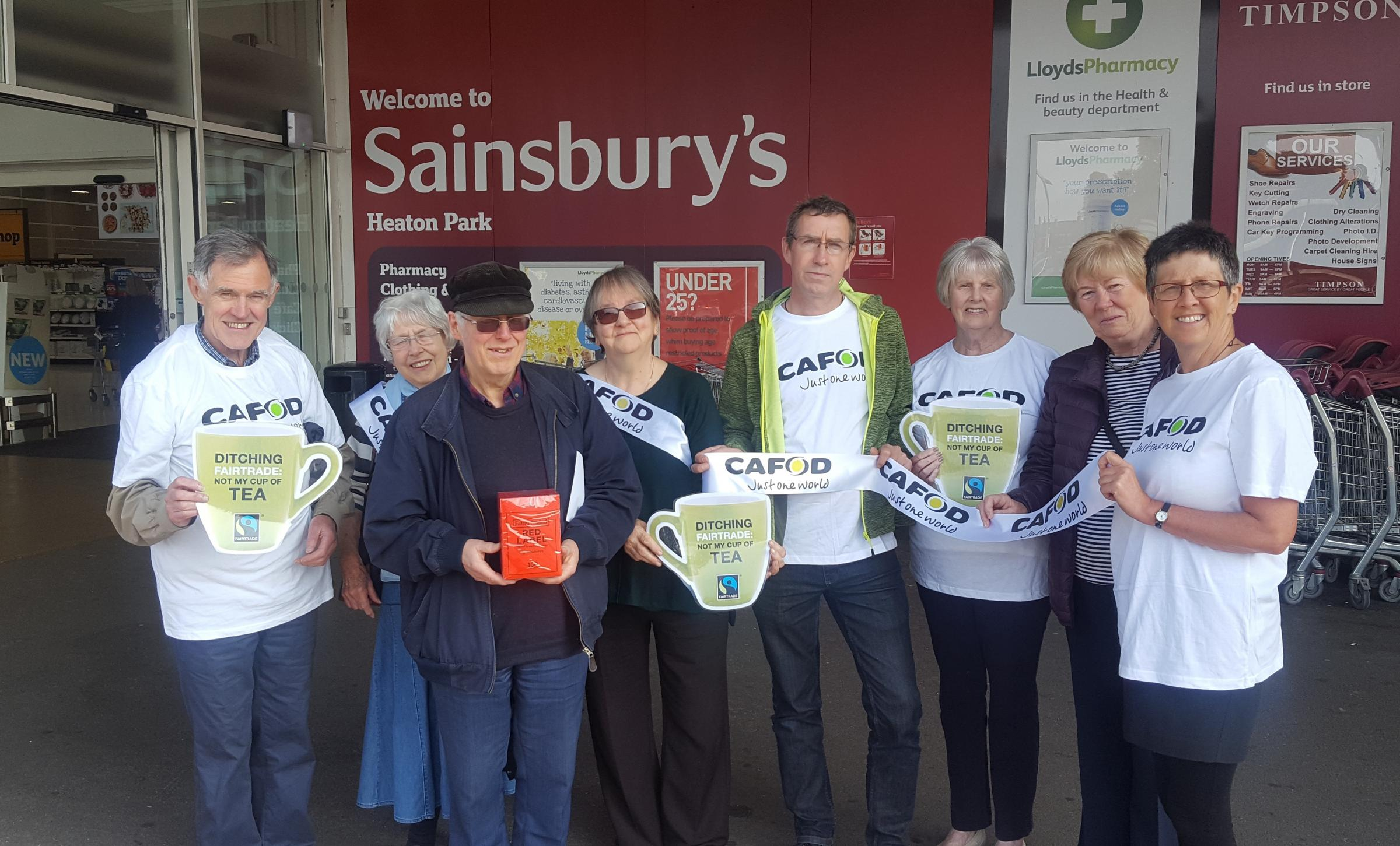 Vin and Sue Allerton with CAFOD volunteers delevering a petition to Sainsbury's