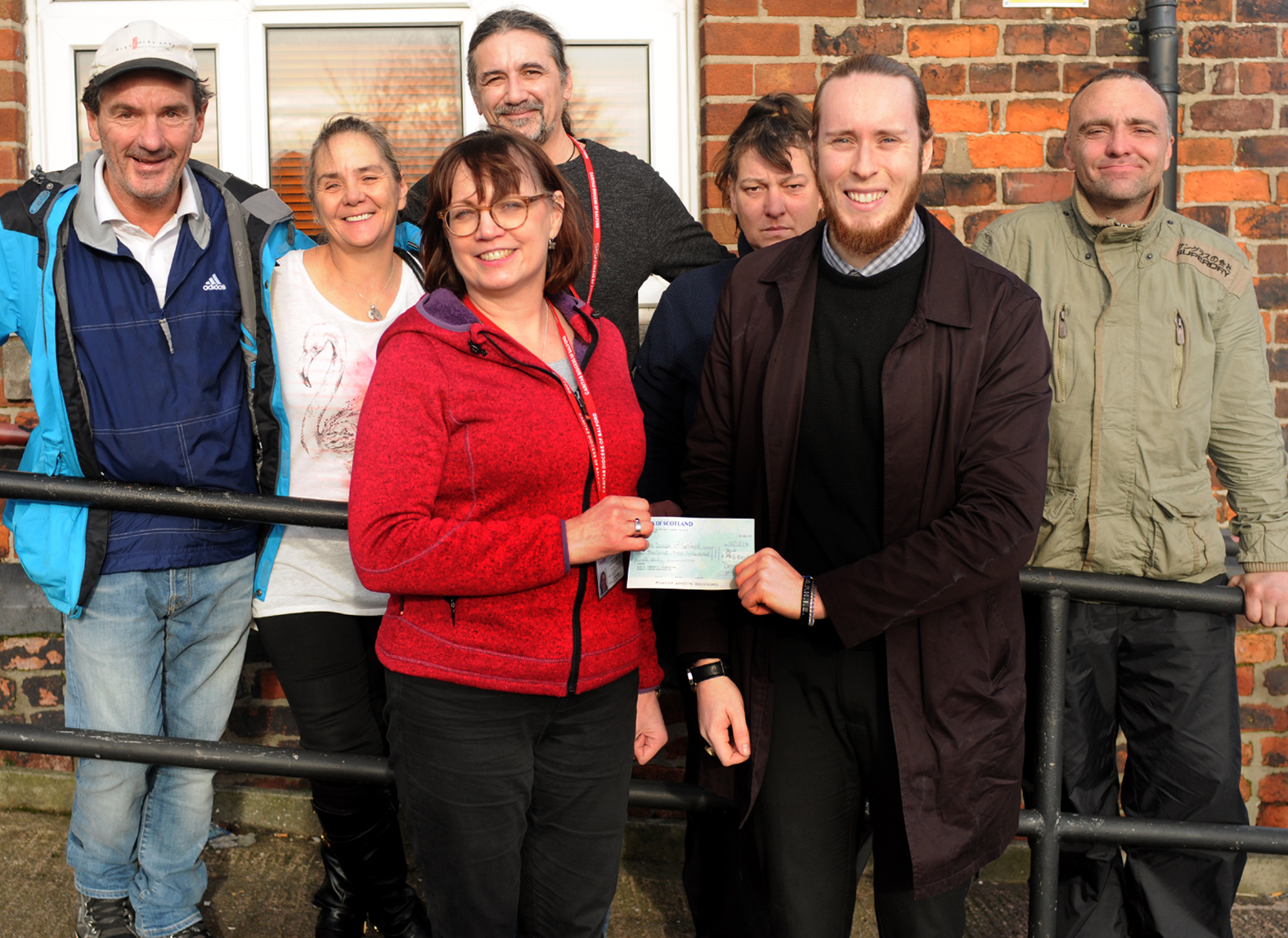 GRANT: Bury Red Door was awarded a grant by the Gannett Foundation. Julia Coulton of Bury Red Door is presented with a cheque by Bury Times reporter Brad Marshall