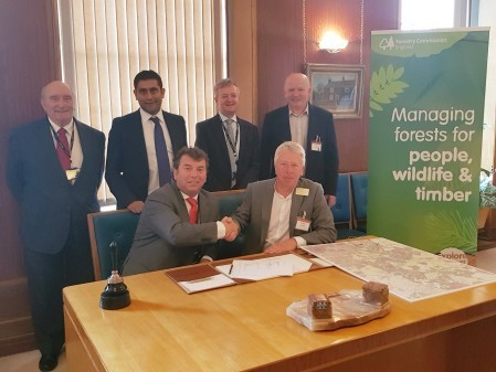 Cllr Alan Quinn and Simon Hodgson, with sign the Memorandum of Understanding, joined by Cllr Tony Cummings, deputy cabinet member for the environment; Cllr Rishi Shori, leader of Bury Council; Geoff Little, chief executive of Bury Council; and Tony Hother