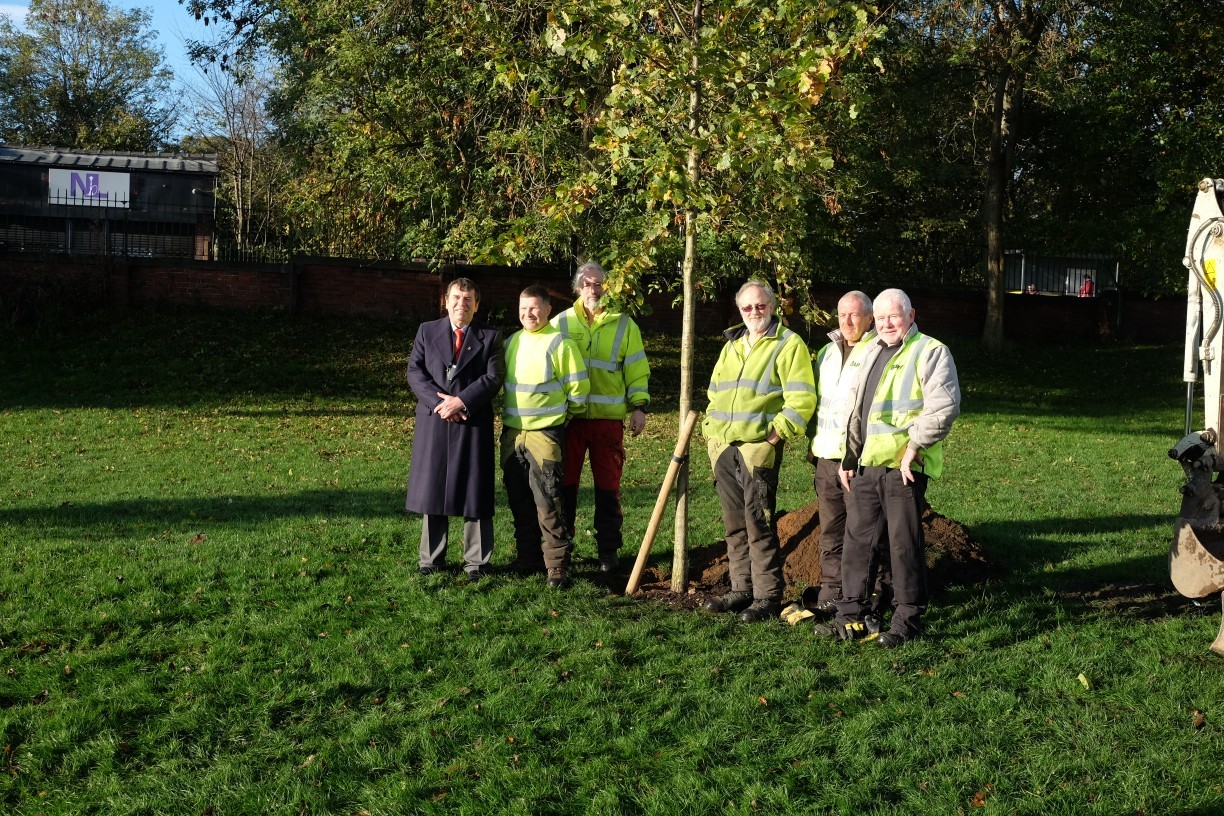 TREE: Councillor Alan Quinn and Bury Council's grounds maintenance team with the new Oak sapling