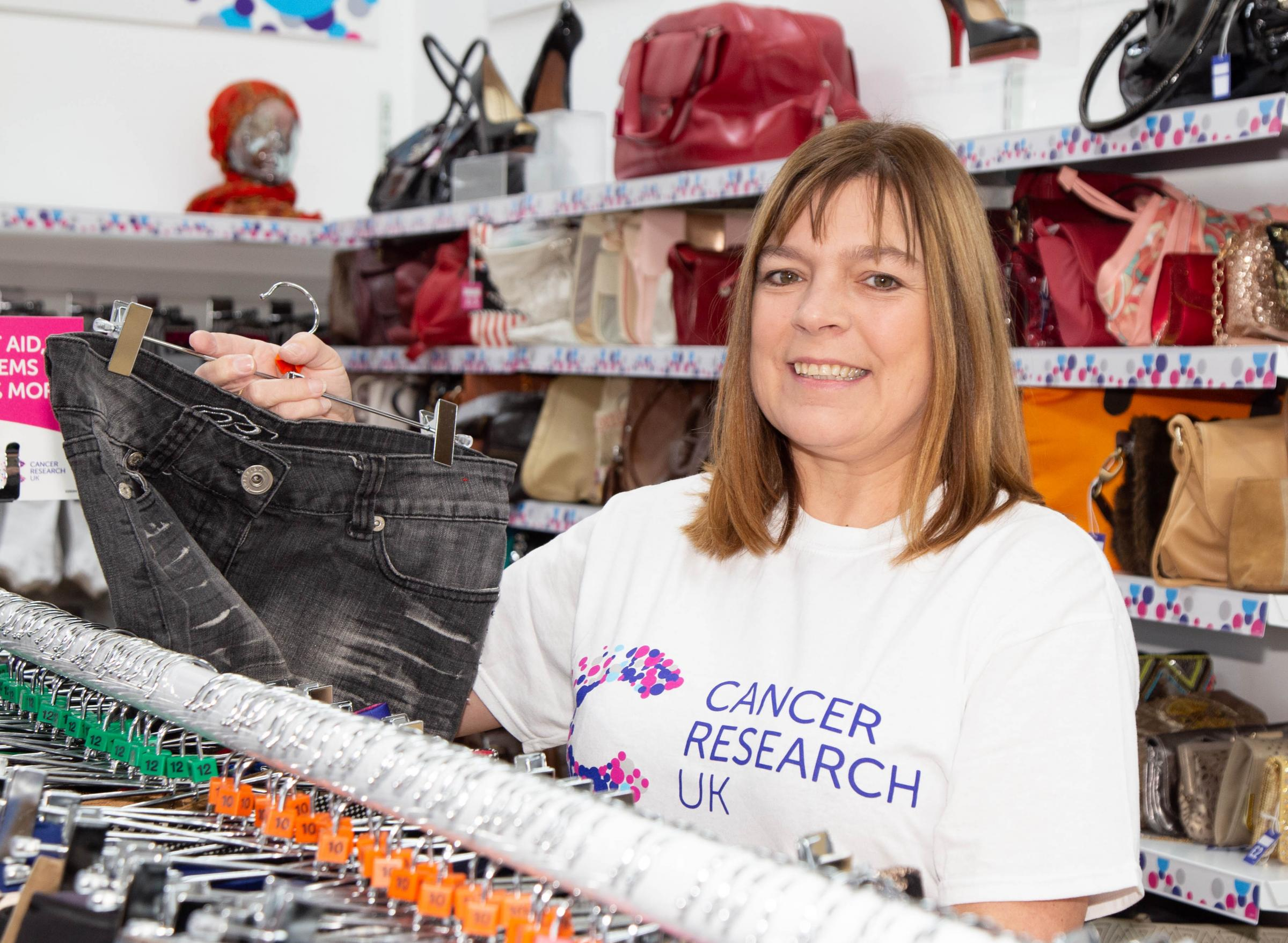 LAUNCH: Carolyn Hall, from Whitefield, cut the ribbon to open the new Cancer Research UK store