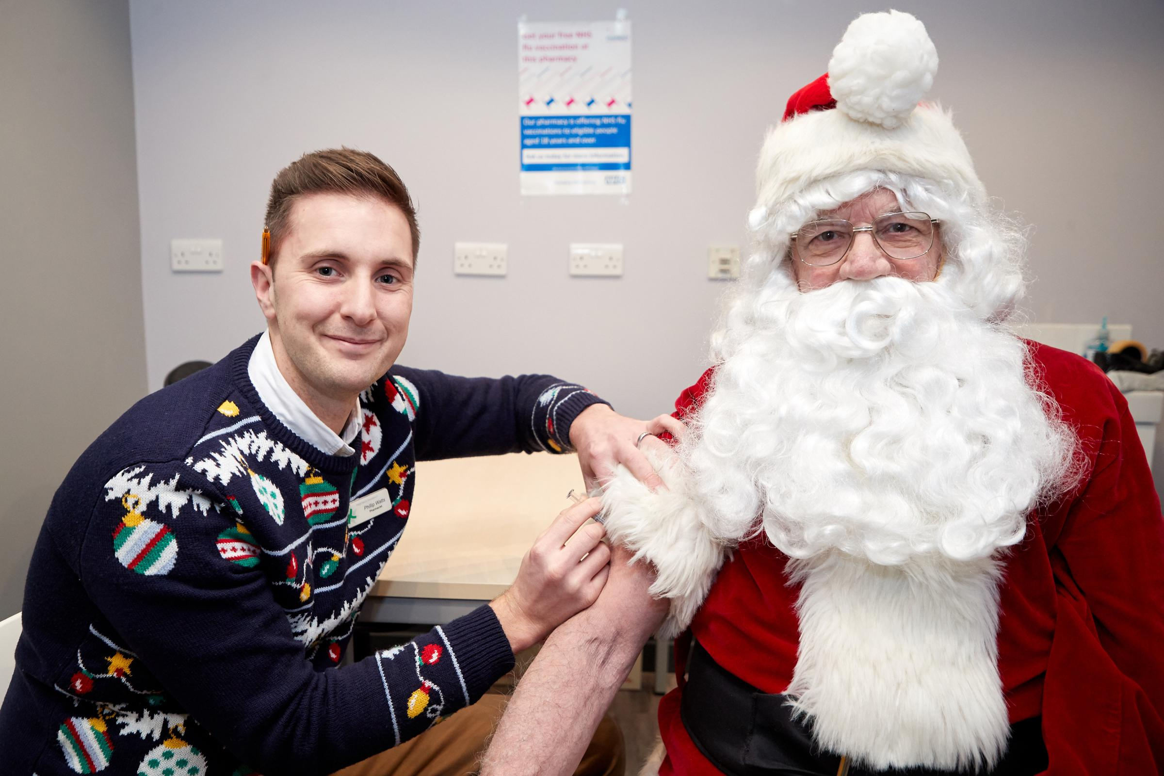 JAB: Father Christmas with Pharmacist Philip Watts at Prestwich Pharmacy. Photo: Paul Greenwood