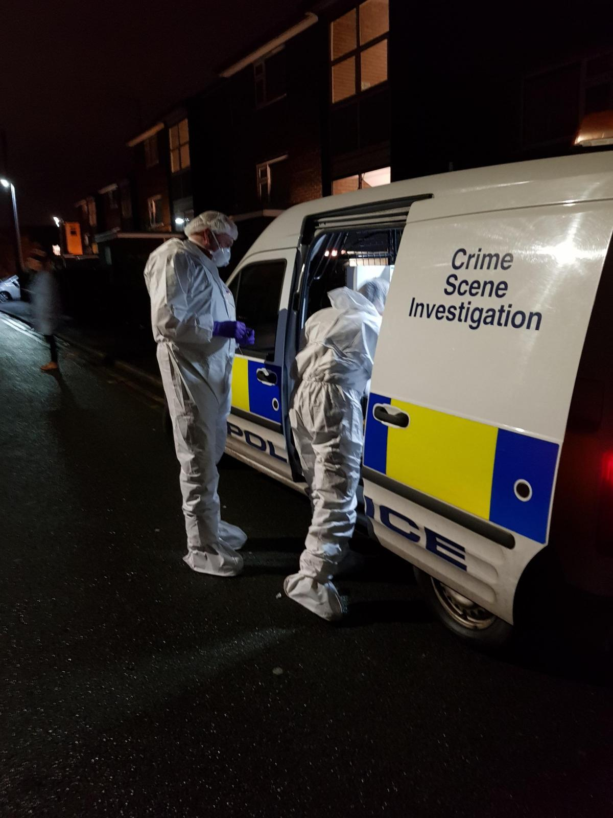 Forensic officers at the scene in Warwick Street, Prestwich on Friday