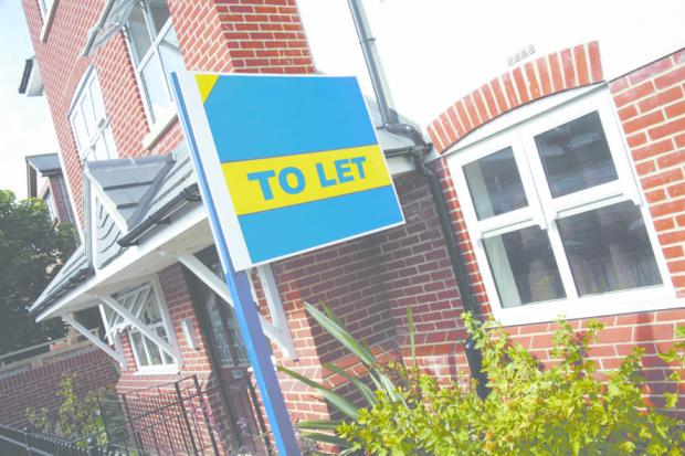 To let sign outside new build houses and flats