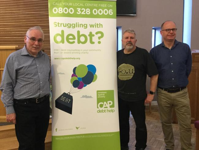 Gordon Clark, Bury CAP Centre Manager (left), David Sutherland and Nigel Thompson, Bury Churches Together (right)